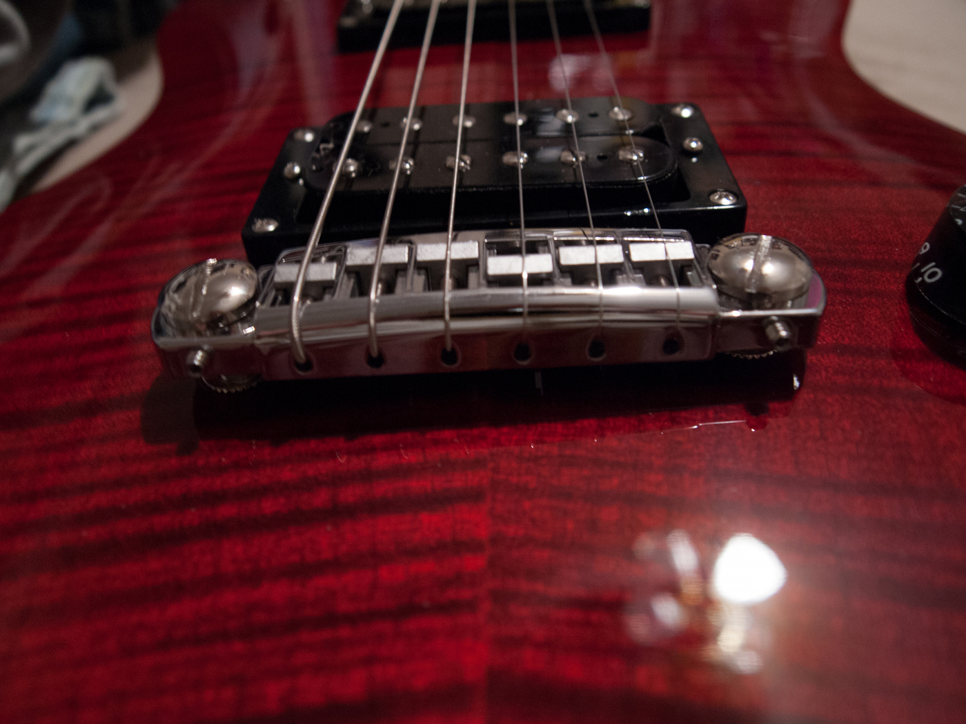 can someone tell me how to adjust intonation on this bridge style guitar. Black Bedroom Furniture Sets. Home Design Ideas